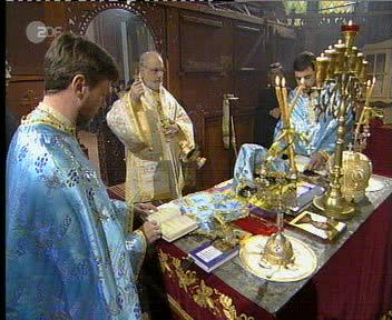 Bishop TICHON Incending the Offerings, Priest LYUBOMIR and Priest YULIAN praying at the Altar